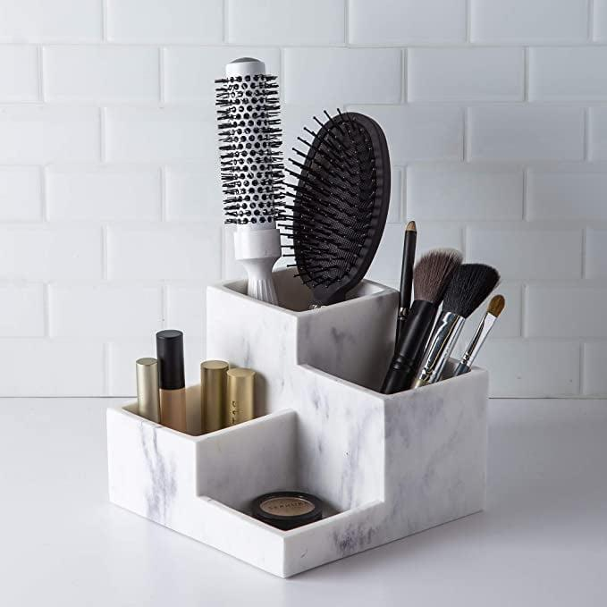 <p>If marble is more your vibe the <span>BINO Multi Purpose 4 Compartment Organizer</span> ($15) will keep your most-used products organized.</p>