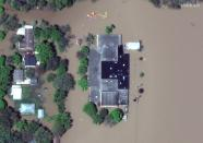 A satellite image shows a flooded Windover High School after rising floodwaters unleashed by two dam failures submerged parts of Midland, Michigan