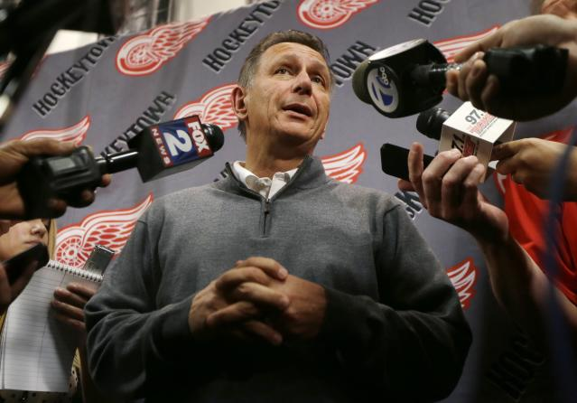 FILE - In this Wednesday, May 20, 2015, file photo, Detroit Red Wings general manager Ken Holland addresses the media, in Detroit, to discuss the head coaching vacancy as coach Mike Babcock will now be the new head hockey coach with the Toronto Maple Leafs. Holland has been elected to the Hockey Hall of Fame's class of 2020. (AP Photo/Carlos Osorio, File)
