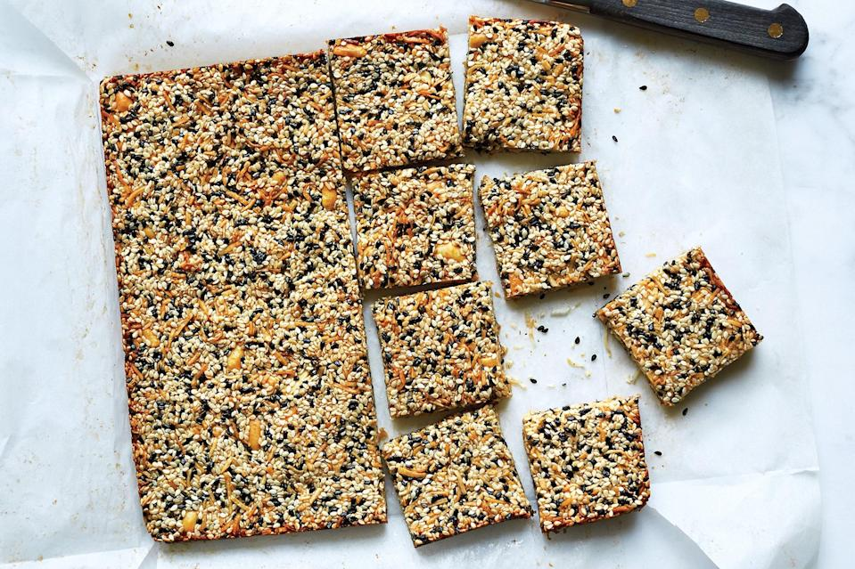 """Toasty sesame seeds add crunch to these treats, which are made without flour. There's just butter, unsweetened shredded coconut, roasted peanuts, honey, and creamy peanut butter. <a href=""""https://www.epicurious.com/recipes/food/views/sesame-peanut-bars-56389975?mbid=synd_yahoo_rss"""" rel=""""nofollow noopener"""" target=""""_blank"""" data-ylk=""""slk:See recipe."""" class=""""link rapid-noclick-resp"""">See recipe.</a>"""
