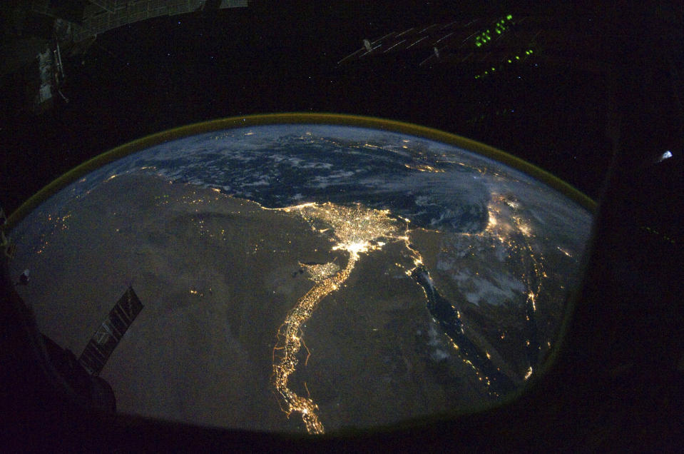 A night time photograph taken by a member of the International Space Station Expedition 25 crew shows the bright lights of Cairo and Alexandria in Egypt, on the Mediterranean coast, as well as the River Nile flowing south from Egypt's capital city. Photo credit: Nasa