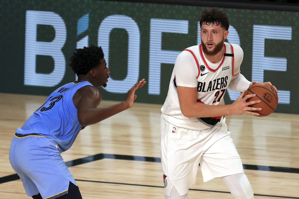 Memphis Grizzlies Jaren Jackson Jr. (3) defends Portland Trail Blazers Jusuf Nurkic (27) during the second half of an NBA basketball game Friday, July 31, 2020, in Lake Buena Vista, Fla. (Mike Ehrmann/Pool Photo via AP)