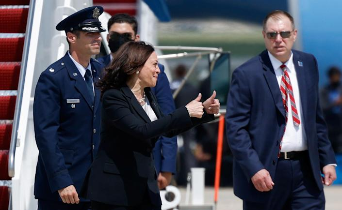 <p>Kamala Harris gives a thumbs-up after her plane was forced to land shortly after take-off</p> (REUTERS)