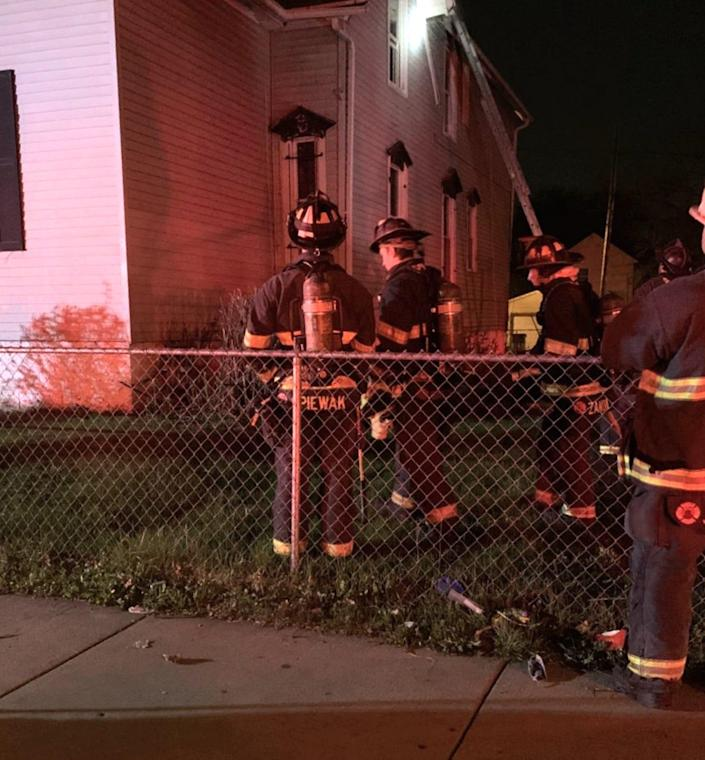 Firefighters on the scene of a fire that gutted the second floor of a duplex near W. North Avenue and N. 15th Street in April 2021. Investigators pointed to faulty electrical wiring as the probable cause.