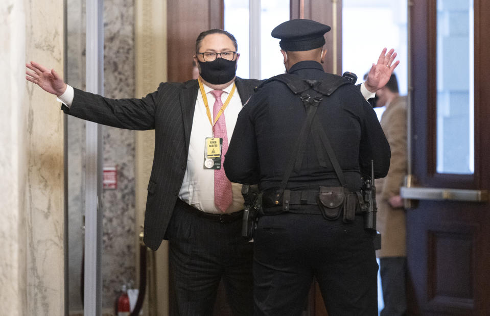 Jason Miller, Senior Adviser to the Trump 2020 re-election campaign, arrives at the Capitol on the fourth day of the second impeachment trial of Trump in the Senate, Friday, Feb. 12, 2021, in Washington. (Bill Clark/Pool via AP)