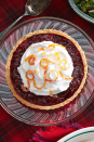 """<p>This zesty, sweet tart will be a showstopper on your New Year's Eve dessert table with its vivid color and twirls of sugared orange peel on top.</p><p><strong><a href=""""https://www.countryliving.com/food-drinks/a29626705/cranberry-tart-recipe/"""" rel=""""nofollow noopener"""" target=""""_blank"""" data-ylk=""""slk:Get the recipe"""" class=""""link rapid-noclick-resp"""">Get the recipe</a>.</strong></p><p><strong><a class=""""link rapid-noclick-resp"""" href=""""https://www.amazon.com/Pyrex-Glass-Plate-9-5-Inch-2-Pack/dp/B00LGLHZNM/?tag=syn-yahoo-20&ascsubtag=%5Bartid%7C10050.g.1078%5Bsrc%7Cyahoo-us"""" rel=""""nofollow noopener"""" target=""""_blank"""" data-ylk=""""slk:SHOP PIE PLATES"""">SHOP PIE PLATES</a><br></strong></p>"""