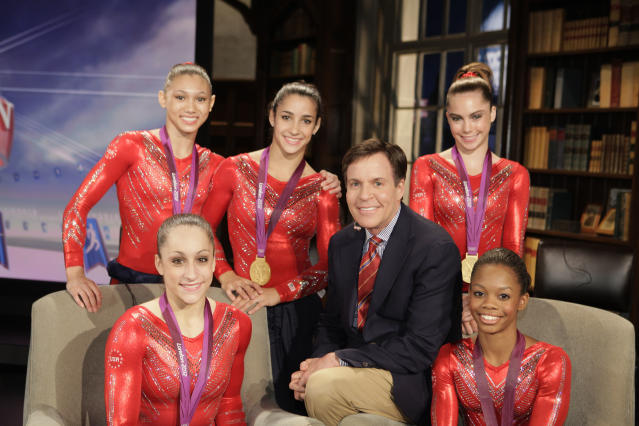 2012 SUMMER OLYMPICS -- US Women's Gymnasts -- Pictured: (l-r) Kyla Ross, Jordyn Wieber, Aly Raisman, Bob Costas, McKayla Maroney, Gabby Douglas -- (Photo by: Paul Drinkwater/NBC/NBCU Photo Bank via Getty Images)