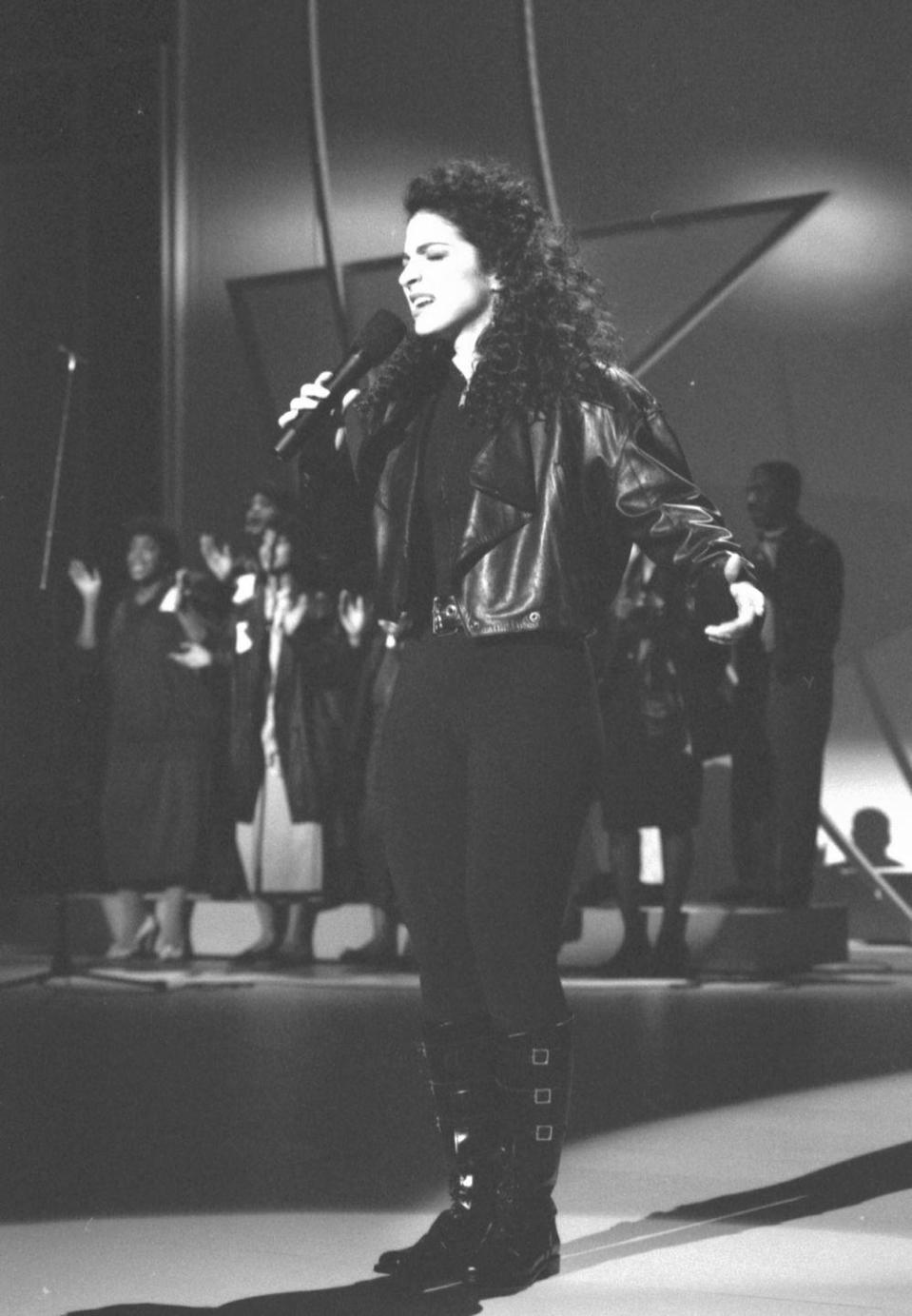 <p>The '80s ushered in an era of edgier shoe trends, as seen here on Gloria Estefan, who wore black leather boots with buckle detailing while performing at a concert. </p>