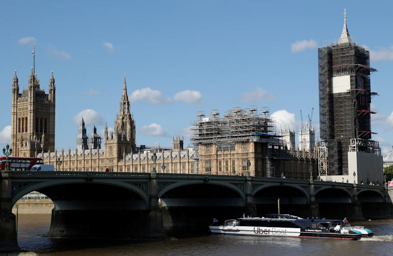 An Uber boat passes under Westminster bridge with the Houses of Parliament in the background, as it operates following the launch of the new boat service on the River Thames in London, Britain, August 3, 2020. REUTERS/John Sibley