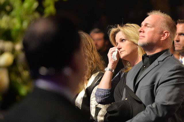 NASHVILLE, TN - MAY 02: (EXCLUSIVE COVERAGE) Country musicians Trisha Yearwood and Garth Brooks attend the funeral service for George Jones at The Grand Ole Opry on May 2, 2013 in Nashville, Tennessee. Jones passed away on April 26, 2013 at the age of 81. (Photo by Rick Diamond/Getty Images for GJ Memorial)