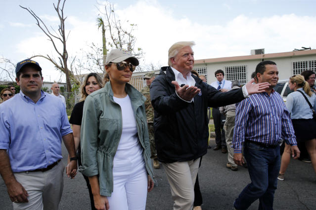 <p>President Donald Trump and first lady Melania Trump walk through a neighborhood damaged by Hurricane Maria in Guaynabo, Puerto Rico, Oct. 3, 2017. (Photo: Jonathan Ernst/Reuters) </p>