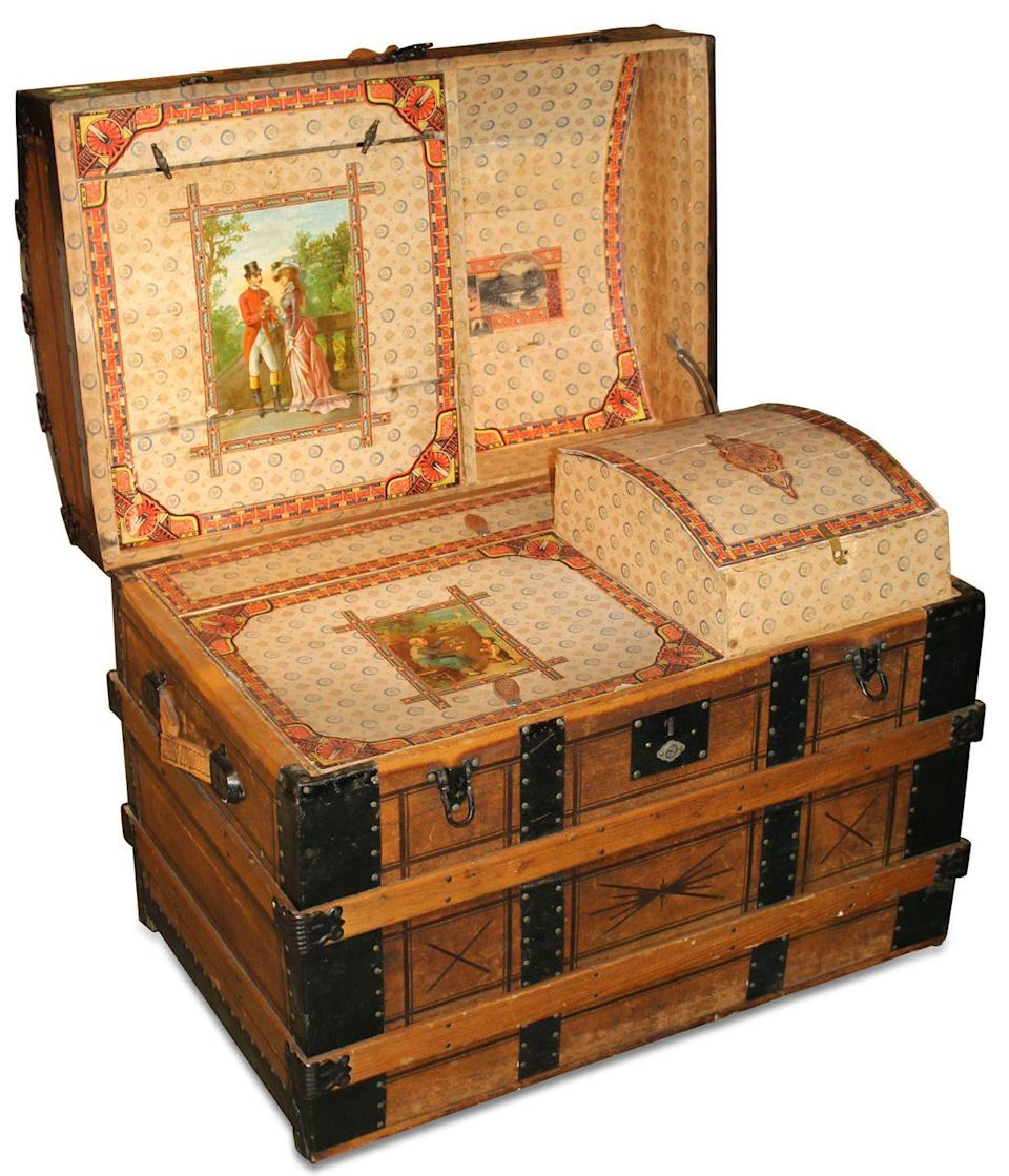 <p>This stunning item dates back to the 1870s, when luggage had to withstand wagon travel, says Marsha Dixey. The interior has multiple storage compartments and is fully lined with its original lithographed paper. The large size is impressive but hardly surprising: Wealthy people of this era typically decamped for the entire summer to places like Saratoga Springs, New York, the popular warm-weather destination for which this dome-topped style is named. </p><p><strong>What it's worth:</strong> $700</p>