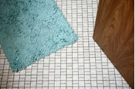"<p>Bathroom rugs are a hot spot for mildew, bacteria, and even fungi, so they should be washed at least every two to three weeks, according to Merry Maids. Before <a href=""https://www.merrymaids.com/cleaning-tips/quick-tips/how-to-wash-bathroom-rugs/"" rel=""nofollow noopener"" target=""_blank"" data-ylk=""slk:washing your bathroom rugs"" class=""link rapid-noclick-resp"">washing your bathroom rugs</a>, check the manufacturer's care label to find washing instructions. Microfiber or chenille can typically be washed with a gentle laundry detergent on the cold setting and dried on the lowest heat setting. </p><p>Plastic- and rubber-backed bathmats can also usually be washed a gentle laundry detergent on the cold setting. However, you should avoid drying plastic- or rubber-backed mats with heat, as it can cause the backing to crack or even melt. </p>"