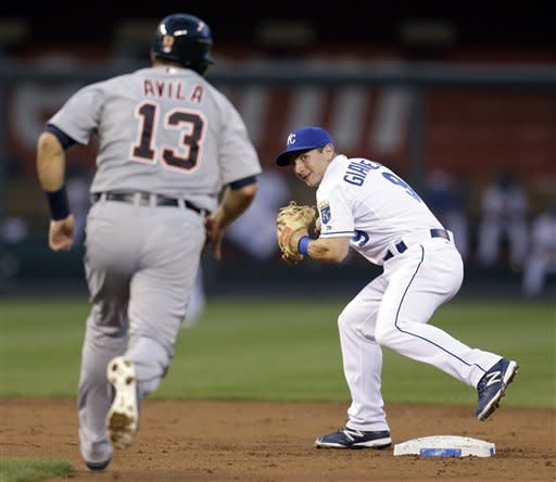 Kansas City Royals second baseman Johnny Giavotella, right, prepares to throw to first for the double play hit into by Detroit Tigers' Austin Jackson after forcing Alex Avila (13) out at second during the third inning of a baseball game on Wednesday, Aug. 29, 2012, in Kansas City, Mo. (AP Photo/Charlie Riedel)