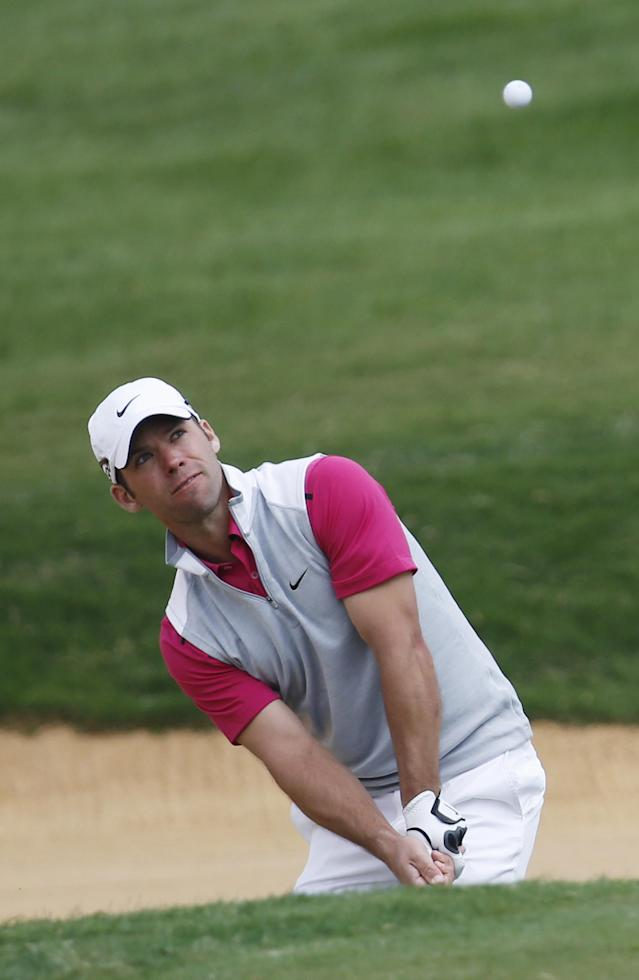 Paul Casey of England hits out of a bunker on the 7th green during the second round of the BMW Masters golf tournament at the Lake Malaren Golf Club in Shanghai, China, Friday, Oct. 25, 2013. (AP Photo/Eugene Hoshiko)