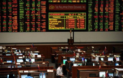 Traders work at the Philippine Stock Exchange in Manila