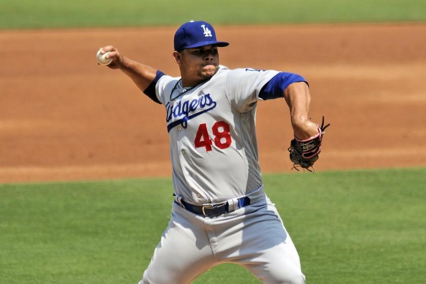 Los Angeles Dodgers starting pitcher Brusdar Graterol delivers a pitch against the San Diego Padres in the first inning of a baseball game Wednesday, Sept. 16, 2020, in San Diego. (AP Photo/Derrick Tuskan)