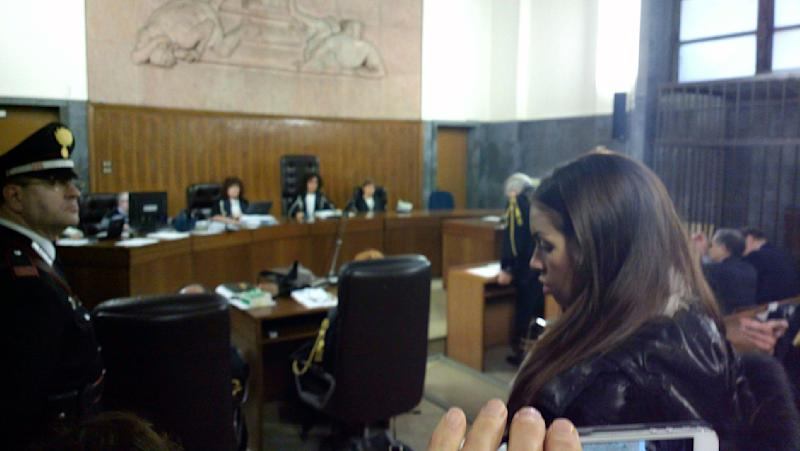 Karima el-Mahroug, the Moroccan woman at the center of ex-Premier Silvio Berlusconi's sex-for-hire trial, arrives in a court room to testify as a witness for the first time, in Milan, Monday, Jan. 14, 2013. El-Mahroug was ordered by the court to appear Monday to testify after failing to show on two previous dates because she was reportedly in Mexico on vacation. She has been called as a defense witness. Berlusconi is accused of paying for sex with woman, better known as Ruby, when she was 17, and then trying to cover it up. Both deny sexual contact. (AP Photo/Luca Bruno)