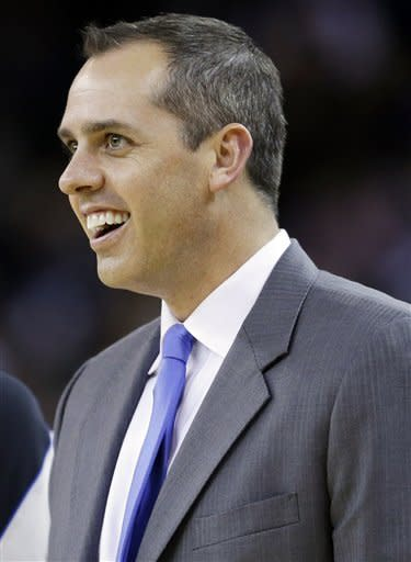 Indiana Pacers coach Frank Vogel smiles as his team play the Golden State Warriors during the first half of an NBA basketball game in Oakland, Calif., Saturday, Dec. 1, 2012. (AP Photo/Marcio Jose Sanchez)