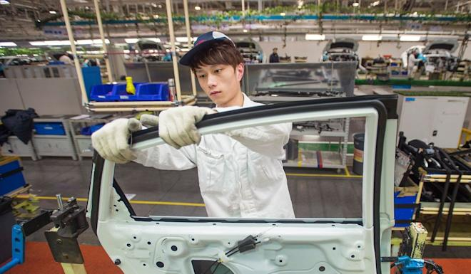 A Dongfeng Honda employee works on the Civic production line at the carmaker's factory in Wuhan, Hubei province. Photo: AFP