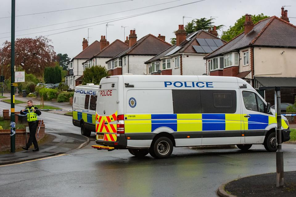 A police cordon around the scene where a teenager was stabbed to death in Harborne, Birmingham on Thursday. (SWNS)