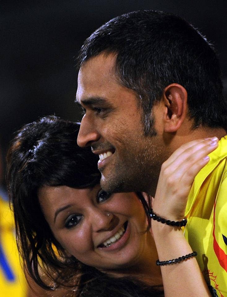 Chennai Super Kings captain Mahendra Singh Dhoni hugs his wife after winning the IPL Twenty20 cricket final match between Chennai Super Kings and Royal Challengers Bangalore at The M.A.Chidambaram Stadium in Chennai on May 28, 2011. Chennai Super Kings won by 58 runs. AFP PHOTO/Indranil MUKHERJEE (Photo credit should read INDRANIL MUKHERJEE/AFP/Getty Images)