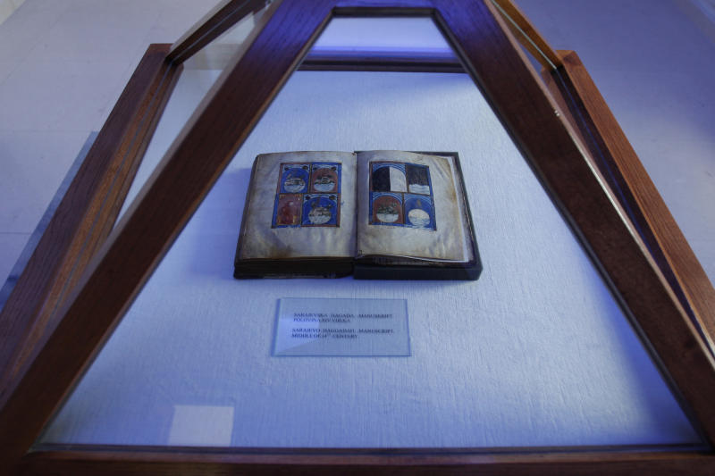 FILE - In this file photo taken on Wednesday, March 31, 2010, the original book of Sarajevo Haggadah, displayed at the National Museum of Bosnia and Herzegovina in Sarajevo, Bosnia. Officials in charge of Bosnia's national monuments said Wednesday, Feb. 6, 2013 they rejected an offer by New York's Metropolitan Museum of Art to exhibit one of Bosnia's most prized relics, a 600-year-old Jewish manuscript that remains locked in a museum which closed because of a lack of money. ( AP Photo/Amel Emric, File)