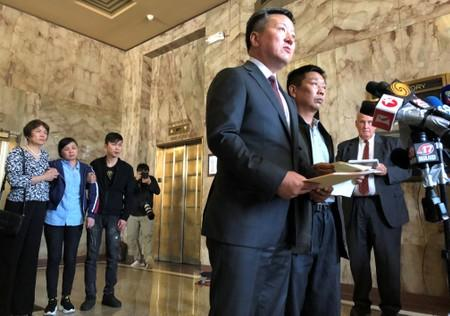 Zhidong Wang, attorney and spokesman for the Zhang family speaks to reporters in Peoria, Illinois