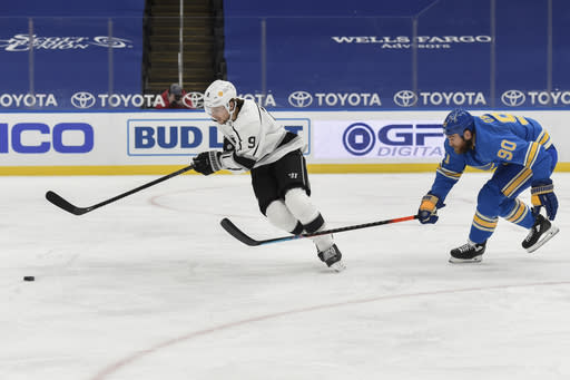 St. Louis Blues' Ryan O'Reilly (90) pressures Los Angeles Kings' Adrian Kempe (9) during the third period of an NHL hockey game Saturday, Jan. 23, 2021, in St. Louis. (AP Photo/Joe Puetz)