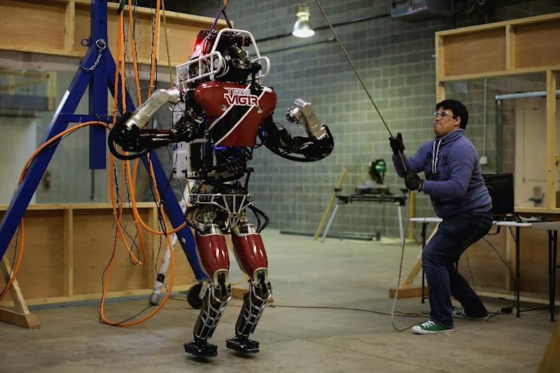 Atlas, a humanoid robot made by Boston Dynamics, can run on different types of surfaces (AFP Photo/CHIP SOMODEVILLA)
