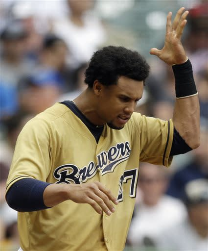 Milwaukee Brewers' Carlos Gomez reacts after striking out during the sixth inning of a baseball game against the New York Mets on Sunday, July 7, 2013, in Milwaukee. (AP Photo/Morry Gash)