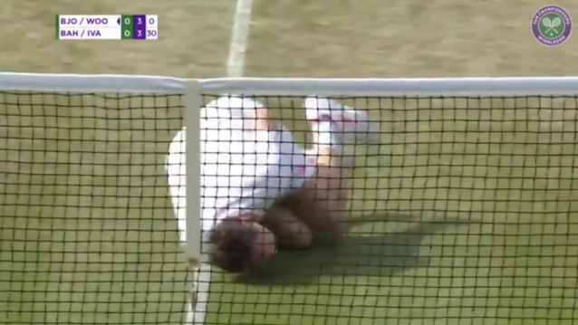 "After being hit by the ball by his own partner, Jonas Bjorkman flopped to the ground and rolled around in ""pain,"" giving fans at Wimbledon on Thursday his best Neymar impression. (Twitter/Wimbledon)"