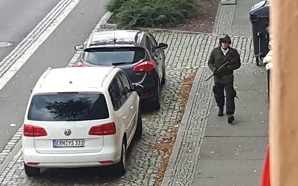 Mandatory Credit: Photo by ANDREAS SPLETT/EPA-EFE/Shutterstock (10714241b) (FILE) - A screenshot of a video shows the suspected neo-Nazi Stephan Balliet with a rifle in Halle, Germany, 09 October 2019 (reissued 17 July 2020). The main trial for the Halle terror attack will start on 21 July 2020. The suspect, a male 27-year-old German neo-Nazi named by the media as Stephan Balliet, went on rampage shooting and killed two people on 09 October 2019 in front of the synagogue and a Kebab shop in Halle during the celebrations on the Jewish holiday of Yom Kippur. Main trial for Halle synagogue shooting to begin, Germany - 09 Oct 2019 - ANDREAS SPLETT/EPA-EFE/Shutterstock