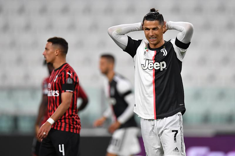 Cristiano Ronaldo of Juventus reacts after missing a penalty during Friday's Coppa Italia semifinal second leg against AC Milan. (Valerio Pennicino/Getty Images)