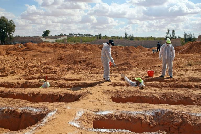 Libyan experts exhume human remains from mass graves in Tarhuna, southeast of the capital Tripoli, on Wednesday