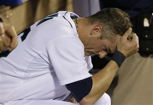 Seattle Mariners' Brendan Ryan rests his head in his hand in the dugout during the seventh inning of a baseball game against the Houston Astros, Tuesday, April 9, 2013, in Seattle. (AP Photo/Ted S. Warren)