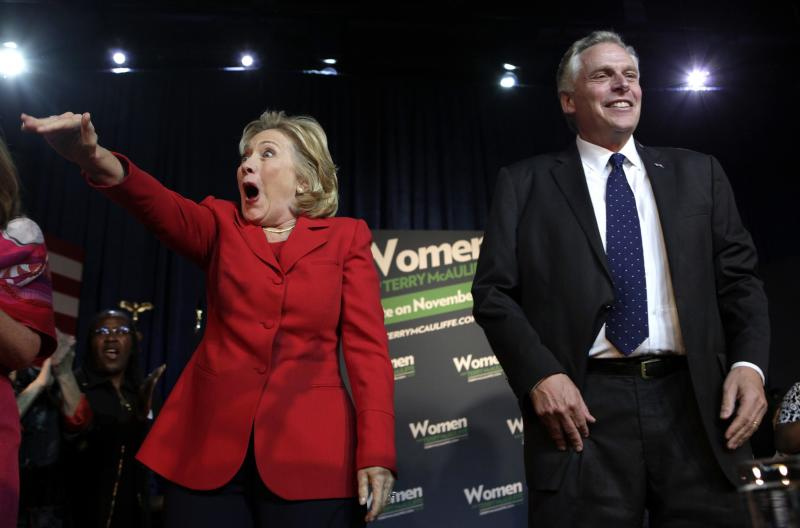 Former U.S. Secretary of State Hillary Clinton greets the audience at an event to endorse Virginia gubernatorial candidate and former DNC chairman Terry McAuliffe (R) at The State Theatre in Falls Church, Virginia, October 19, 2013. REUTERS/Yuri Gripas (UNITED STATES - Tags: POLITICS ELECTIONS)