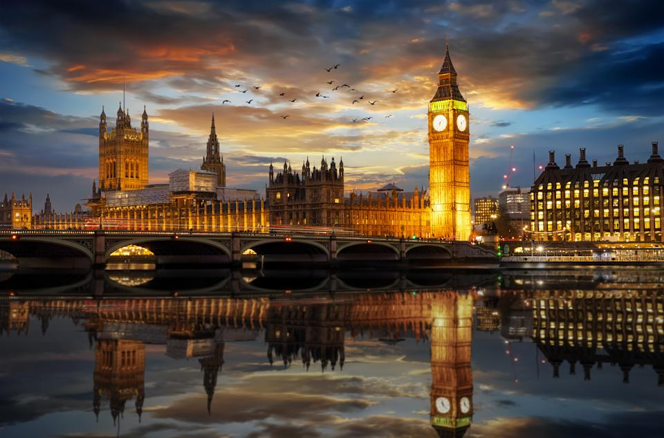 Westminster and the Big Ben clocktower by the Thames river in London, United Kingdom, just after sunset