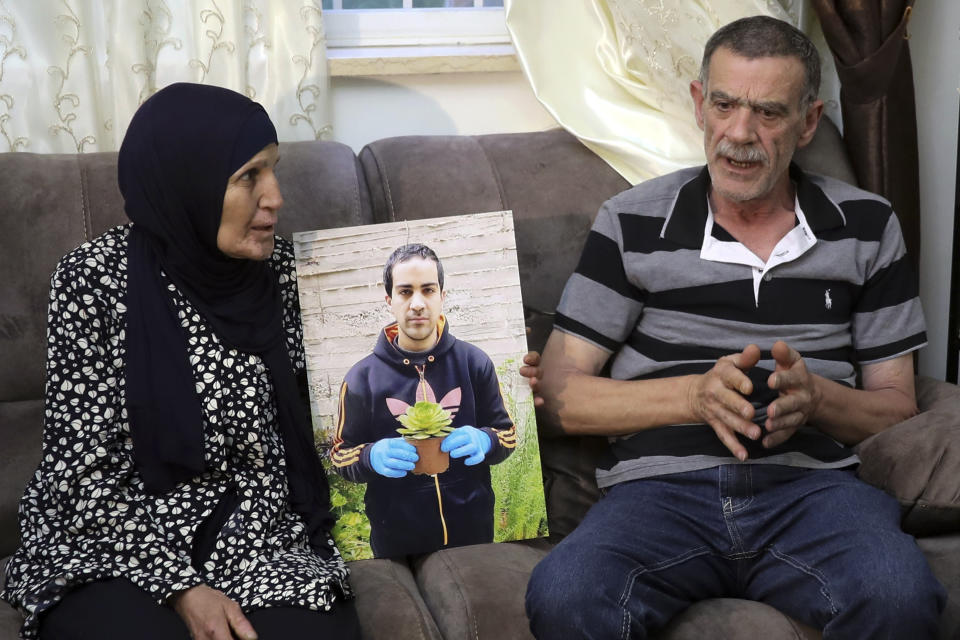 Parents of Eyah Hallaq, an autistic Palestinian man who was fatally shot by Israeli police, Khiri and mother Rana, talk during an interview In Jerusalem, Wednesday, June 3, 2020. The family says it is hopeful the officers will be prosecuted after finally confirming the existence of security-camera footage of the incident.(AP Photo/Mahmoud Illean)