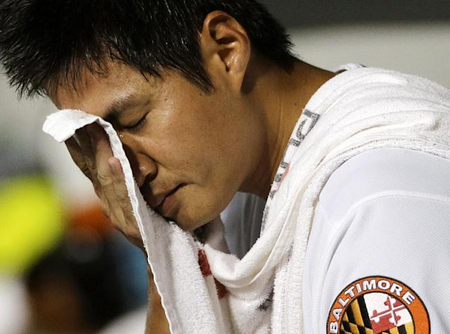 Baltimore Orioles starting pitcher Wei-Yin Chen, of Taiwan, wipes sweat from his brow after being relieved in the seventh inning of a baseball game against the New York Yankees, Thursday, Sept. 12, 2013, in Baltimore. (AP Photo/Patrick Semansky)