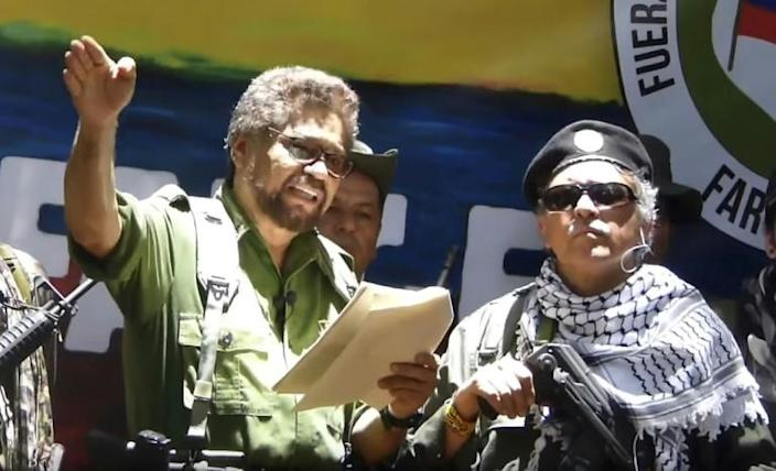 Former senior commander of the dissolved FARC rebel group Ivan Marquez (L) and fugitive rebel Jesus Santrich (R) are pictured in a video published on August 29, 2019 announcing their return to arms (AFP Photo/HO)