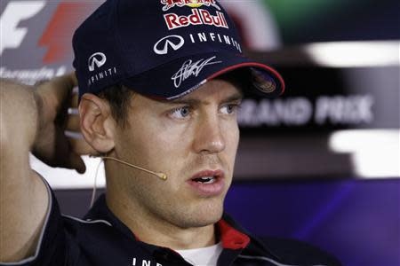 Red Bull Formula One driver Vettel of Germany attends a news conference ahead of the Abu Dhabi F1 Grand Prix at the Yas Marina circuit in Abu Dhabi