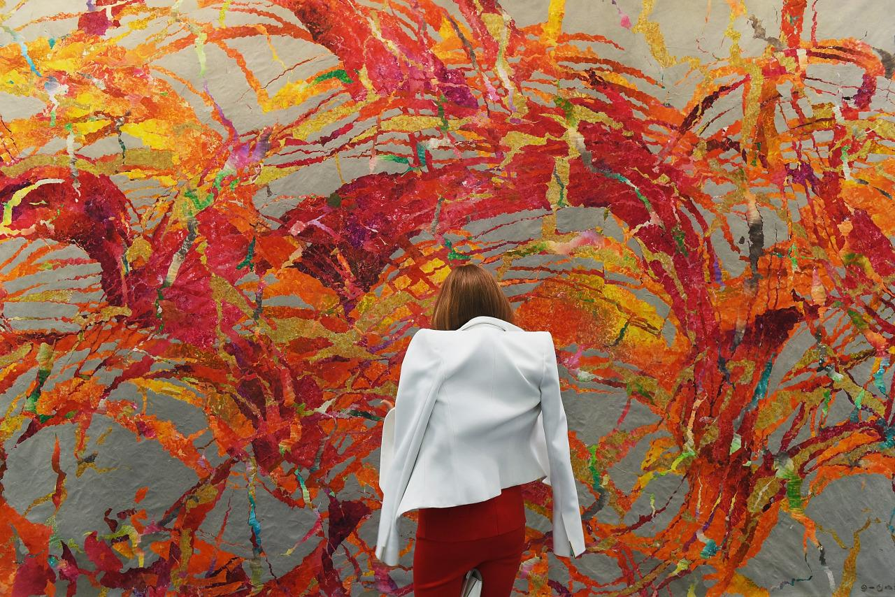 A visitor to Art16 studies 'Fissuring, 2015' by Qui Deshu, which is on display at the Pearl Lam Galleries stand at Kensington Olympia. (Mary Turner/Getty Images for Pearl Lam Galleries)