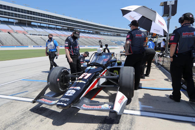 Team members make final adjustments to the car as Rinus Veekay sits in the cockpit waiting during practice for the IndyCar auto race at Texas Motor Speedway in Fort Worth, Texas, Saturday, June 6, 2020. (AP Photo/Tony Gutierrez)