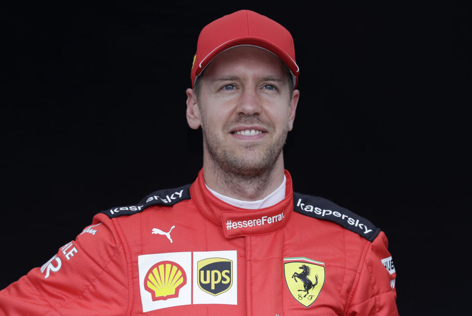 Ferrari driver Sebastian Vettel of Germany poses for a photo at the Australian Formula One Grand Prix in Melbourne, Thursday, March 12, 2020. (AP Photo/Rick Rycroft)