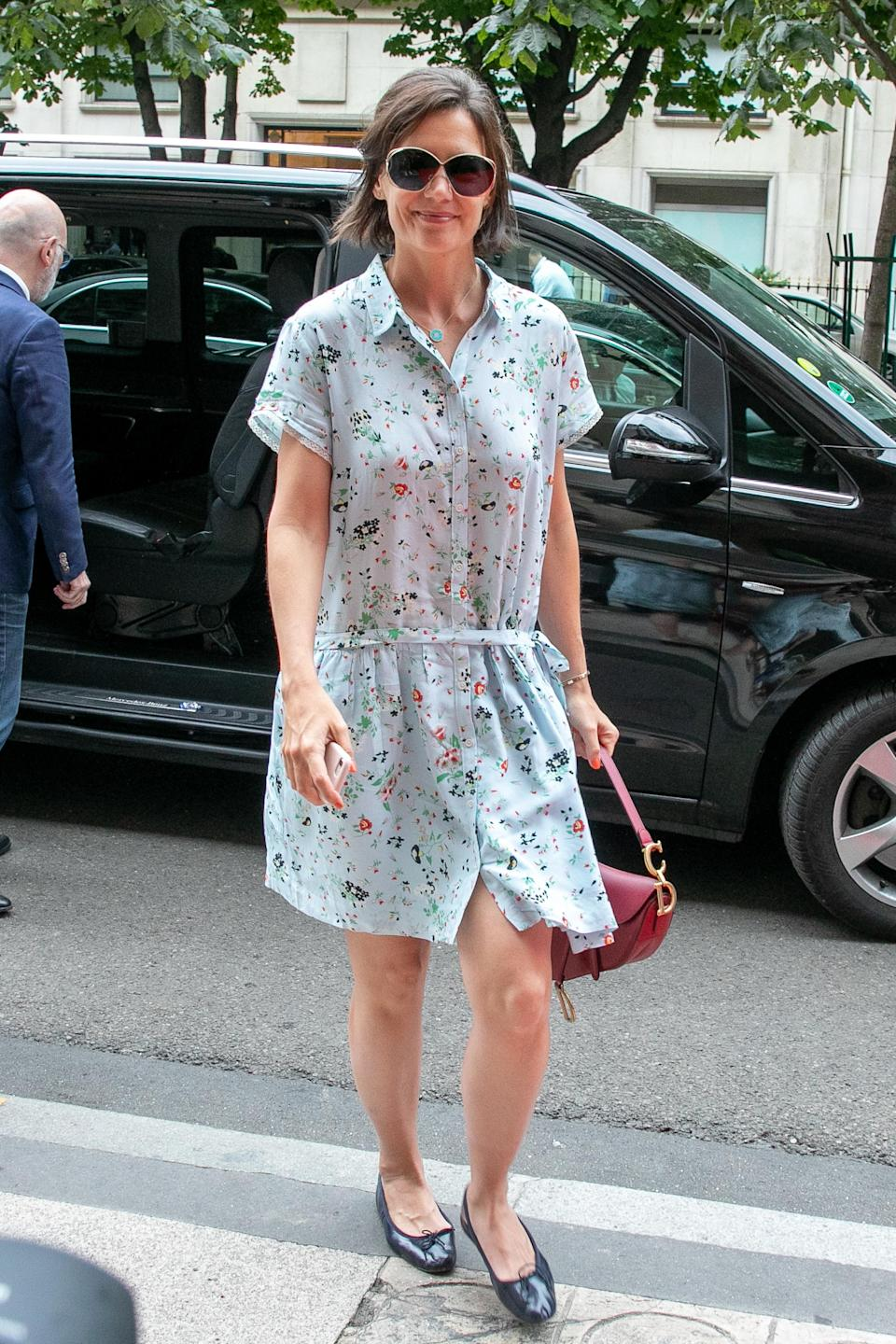 <p>Katie Holmes was spotted out and about in Paris on 1 July with daughter Suri in tow. Demonstrating how to dress for the summer heat, the actress donned a floral shirt dress accessorised with one of Dior's famous saddle bags. <em>[Photo: Getty]</em> </p>
