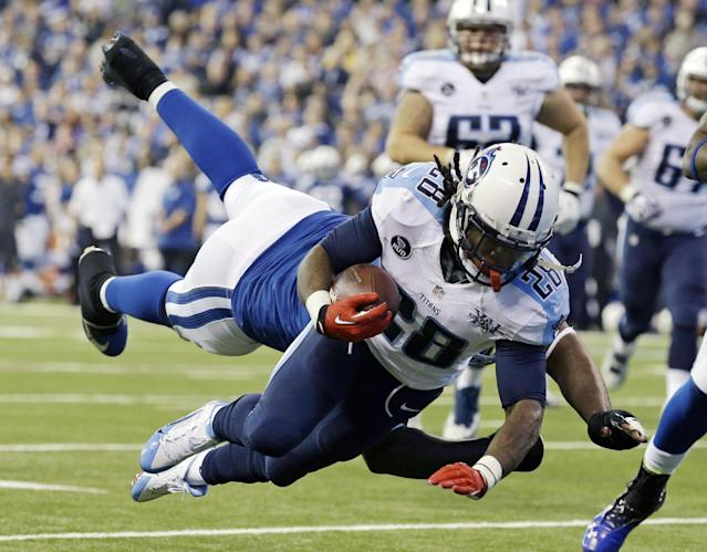 Tennessee Titans' Chris Johnson (28) dives while being tackled by Indianapolis Colts' Cory Redding during the first half of an NFL football game Sunday, Dec. 1, 2013, in Indianapolis. (AP Photo/Michael Conroy)