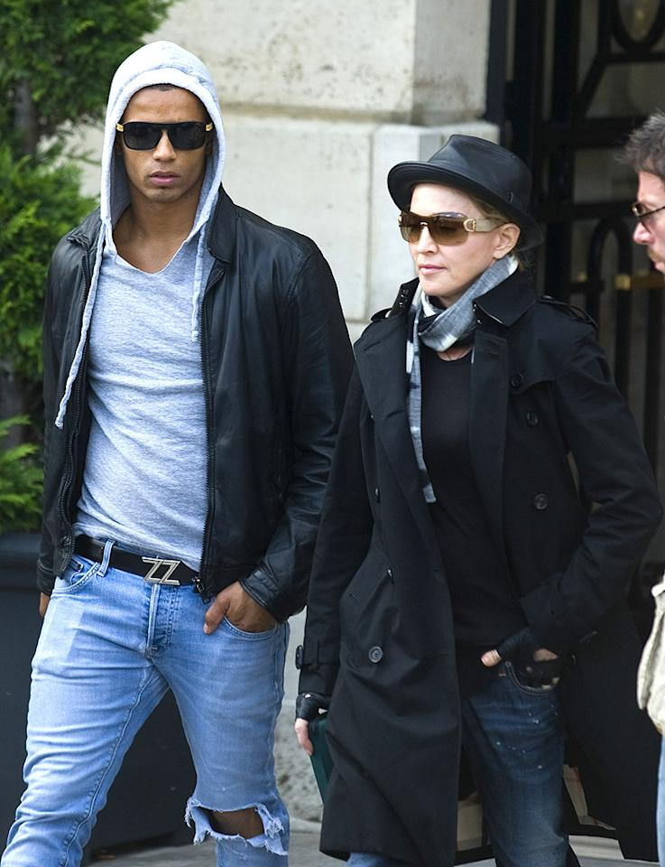 "<p class=""MsoNormal"">After flashing Parisian audiences at her latest concert on the MDNA tour, Madonna covered up for a day out with her boyfriend Brahim Zaibat. The 53-year-old superstar took her 24-year-old boy toy and her kids out for a boat ride on the Seine. (7/15/2012)</p>"