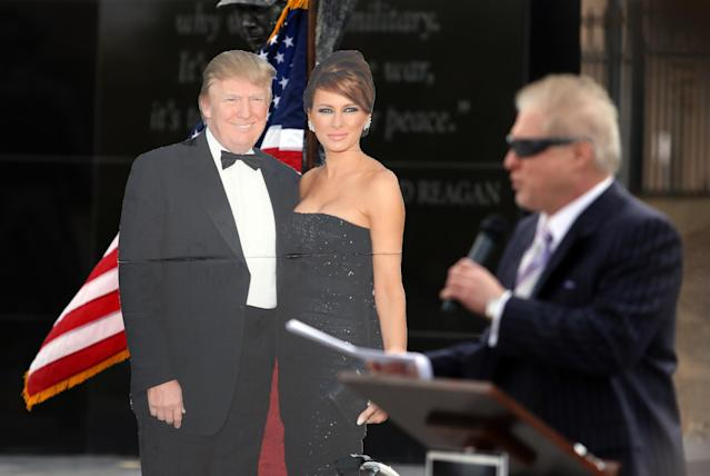 Wayne Allyn Root, USA Radio Network host, takes the podium next to a life-size cutout of Donald and Melania Trump.  (Photo: Ronda Churchill for Yahoo)