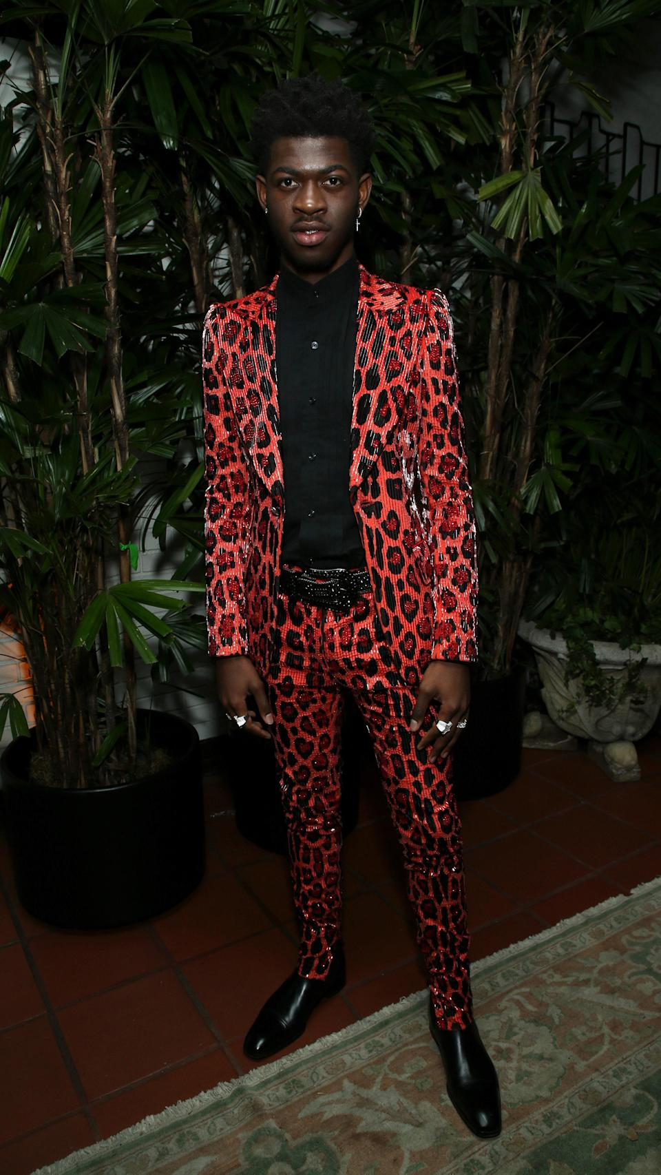 Nothing screams statement like a red, leopard-print suit.